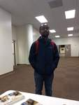 Josiah Sherman with a Red Backpack by Xavier University of Louisiana