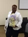 Deborah M. Nolan, Office of Graduate Placement, Xavier University of Louisiana, holding a gift bag by Xavier University of Louisiana